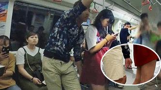 地鐵里被偷拍裙底女漢子狂追色狼